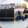 Playstation 3 + 4 manettes + 5 jeux